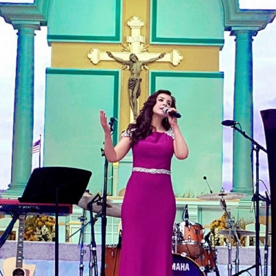 Margaret performing at the Pre- Papal concert to an audience of 5million